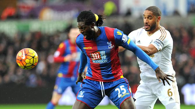 Swansea City's Ashley Williams, right, and Crystal Palace's Emmanuel Adebayor vie for the ball,  during the English Premier League soccer match between Swansea and Crystal Palace, at the Liberty Stadium, in Swansea, Wales, Saturday, Feb. 6, 2016. (Simon Galloway/PA via AP) UNITED KINGDOM OUT
