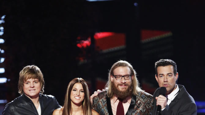 "This Monday, Dec. 17, 2012 file photo released by NBC shows host, Carson Daly, right, with the three finalists, from left, Terry McDermott, Cassadee Pope and Nicholas David, on ""The Voice,"" ""Live Show"" Episode 323A on the part one season 3 finale in Los Angeles.  The contestants vie for the title in the NBC reality show on Dec. 18. (AP Photo/NBC, Tyler Golden)"