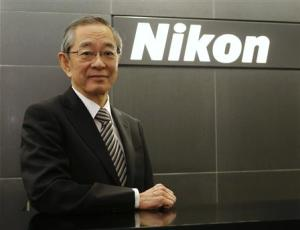 Nikon Corp's President Makoto Kimura poses in front of the company logo before an interview with Reuters in Tokyo