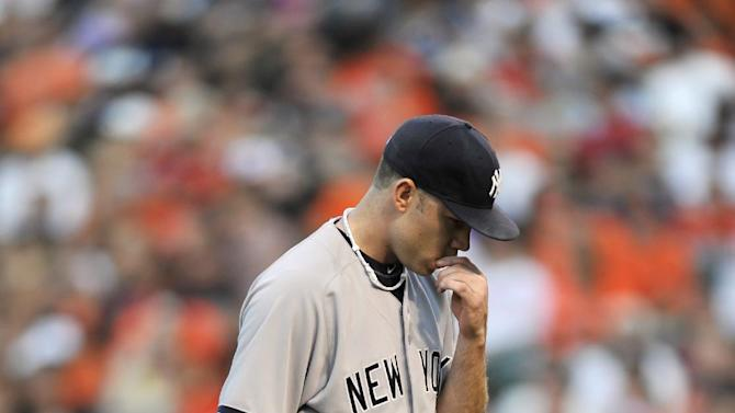 New York Yankees pitcher Kevin Phelps walks to the dugout after giving up four runs to the Baltimore Orioles in the first inning of a baseball game, Saturday, June 29, 2013, in Baltimore. (AP Photo/Gail Burton)