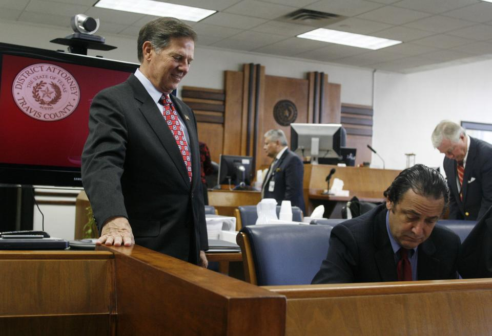 Former House Majority Leader Tom DeLay waits for his attorneys to finish paperwork inside the Travis County courthouse in Austin, Texas on Tuesday, Oct. 26, 2010 before the start of jury selection in his corruption trial. The 63-year-old DeLay is charged with money laundering and conspiracy to commit money laundering. (AP Photo/Jack Plunkett)