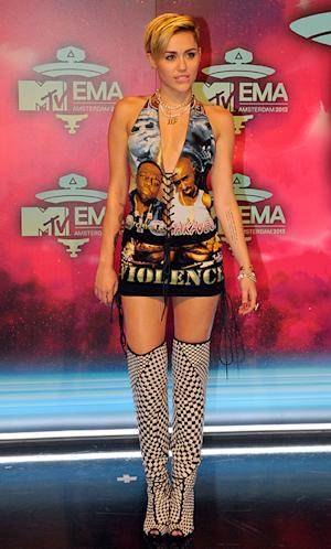 Miley Cyrus Arrives at the MTV EMA Awards Wearing a Dress With Biggie Smalls and Tupac, Knee-High Boots