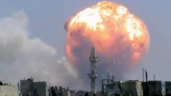 In this image taken from video posted by Ugarit News, which has been authenticated based on its contents and other AP reporting, purports to show a fireball from an explosion at a weapons depot set off by rocket attacks that struck government-held districts in the central Syrian city of Homs on Thursday, Aug. 1, 2013. The blasts sent a massive ball of fire into the sky, killing scores and causing widespread damage and panic among residents, many of whom are supporters of President Bashar Assad.(AP Photo/Ugarit News via AP video)