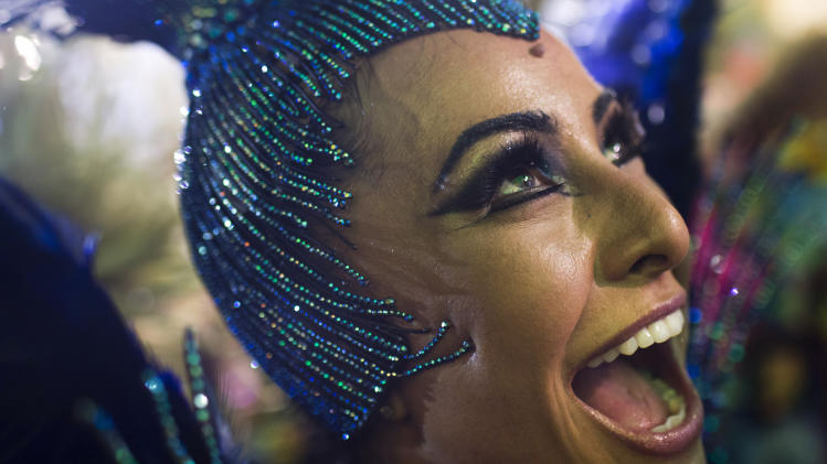 Drum queen Sabrina Sato from the Unidos de Vila Isabel samba school parades during Carnival celebrations at the Sambadrome in Rio de Janeiro, Tuesday, Feb. 12, 2013. Rio de Janeiro's samba schools vied for the title of the year's best in an over-the-top, all-night-long Carnival parade at the city's iconic Sambadrome. (AP Photo/Felipe Dana)