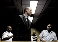 "South Africa's Olympic sprinter Oscar Pistorius leaves the court room after his hearing on charge of murdering his model girlfriend Reeva Steenkamp on Valentine's Day, on February 15, 2013 at the Magistrate Court in Pretoria. Pistorius's uncle has said the jailed track star was ""numb with shock"" and grief following the death Steenkamp"