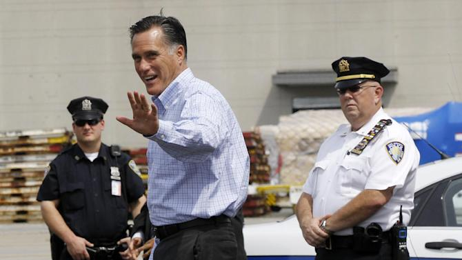 Republican presidential candidate, former Massachusetts Gov. Mitt Romney steps off his charter plane as he arrives in Newark, N.J., Wednesday, Aug. 8, 2012, for campaign fundraising events. (AP Photo/Charles Dharapak)