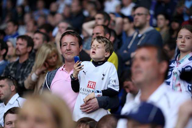 Tottenham Hotspur fans stand dejected after failing to claim a Champions League position after the Barclays Premier League match at White Hart Lane, London.