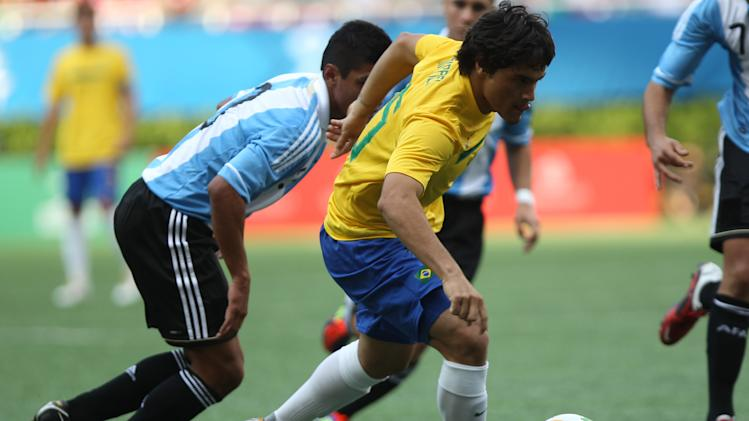 Brazil's Misael Bueno, right, is chased by Argentina's Lucas  Kruspzkiy during a men's soccer match at the Pan American Games in Guadalajara, Mexico, Wednesday, Oct. 19, 2011. (AP Photo/Juan Karita)