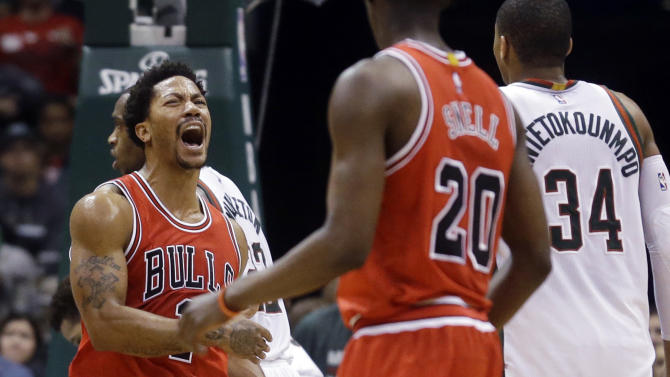 Chicago Bulls' Derrick Rose reacts after scoring during the second overtime of Game 3 of an NBA basketball first-round playoff series against the Milwaukee Bucks on Thursday, April 23, 2015, in Milwaukee. The Bulls won 113-106 to take a 3-0 lead in the series. (AP Photo/Morry Gash)