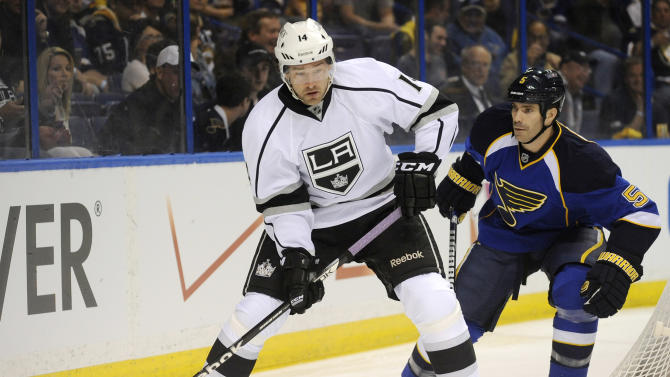 Los Angeles Kings' Justin Williams (14) looks to pass in front of St. Louis Blues' Barret Jackman (5) during the first period of Game 1 of their first-round NHL hockey Stanley Cup playoff series, Tuesday, April 30, 2013, in St. Louis. (AP Photo/Bill Boyce)