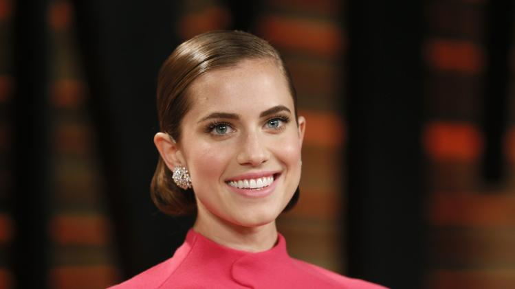 Actress Allison Williams arrives at the 2014 Vanity Fair Oscars Party in West Hollywood in this file photo