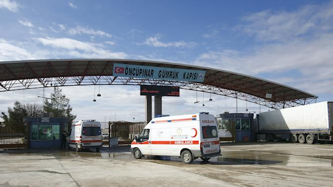 Ambulances enter Syria from Turkey at Turkey's Oncupinar border crossing on the Turkish-Syrian border in the southeastern city of Kilis, Turkey