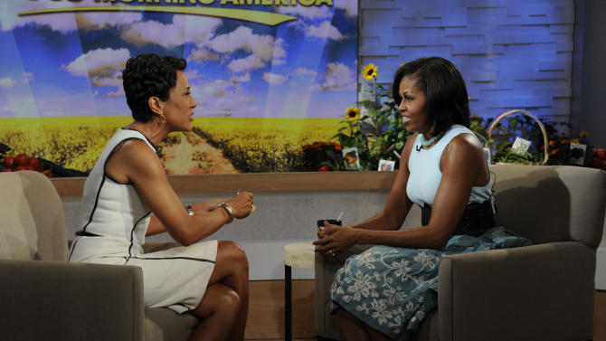 "This image released by ABC shows  host Robin Roberts, left, speaking with first lady Michelle Obama on the morning program ""Good Morning America,"" Tuesday, May 29, 2012 in New York. Obama discussed a variety of topics including her new book ""American Grown: The Story of the White House Kitchen Garden and Gardens Across America,"" which promotes healthy eating. (AP Photo/ABC, Ida Mae Astute)"