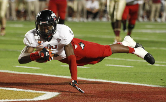 Northern Illinois Huskies' Moore scores a touchdown against Florida State Seminoles during their 2013 Discover Orange Bowl NCAA football game in Miami