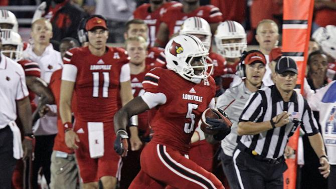 Louisville quarterback Teddy Bridgewater runs during the first half of an NCAA college football game against Rutgers in Louisville, Ky., Thursday, Oct. 10, 2013. (AP Photo/Garry Jones)