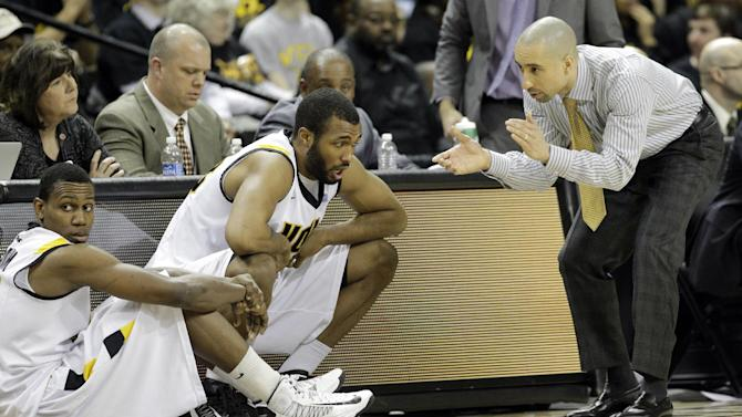 Virginia Commonwealth head coach Shaka Smart,right, rally's guard Treveon Graham, left, and  D.J. Haley (33) during the first second of an NCAA college basketball game against Butler in Richmond, Va., Saturday, March 2, 2013.  VCU won 84-52.  (AP Photo/Steve Helber)