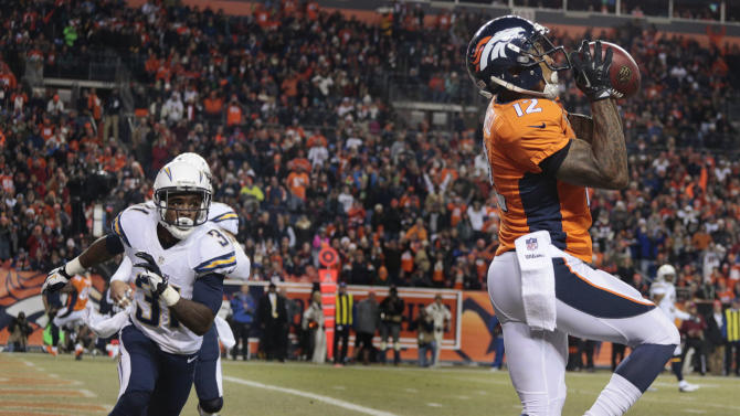 Denver Broncos wide receiver Andre Caldwell (12) catches a pass for a touchdown in front of San Diego Chargers cornerback Richard Marshall (31) in the first quarter of an NFL football game, Thursday, Dec. 12, 2013, in Denver. (AP Photo/Joe Mahoney)