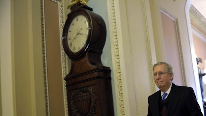 Senate Minority Leader Mitch McConnell of Ky. walks to the Senate floor on Capitol Hill in Washington, Thursday, Dec. 27, 2012. (AP Photo/Susan Walsh)