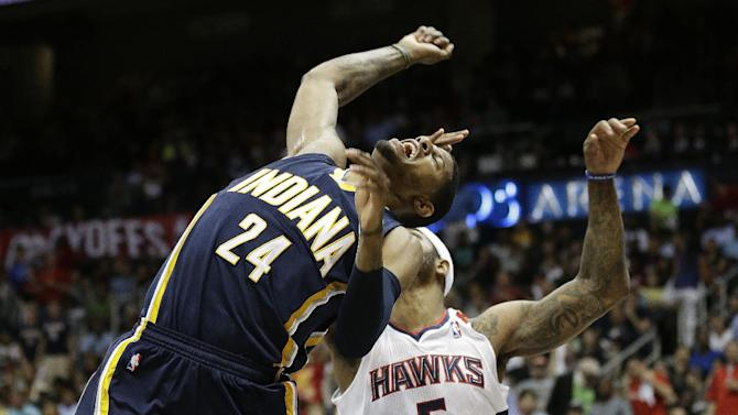 Indiana Pacers small forward Paul George (24) reacts after missing a shot under the basket against Atlanta Hawks small forward Josh Smith (5) during the first half in Game 3 of their first-round NBA basketball playoff series, against the Indiana Pacers, Saturday, April 27, 2013 in Atlanta. (AP Photo/John Bazemore)