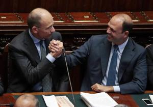 Italy's PM Letta is congratulated by Interior Minister Alfano at the Lower house of the parliament in Rome