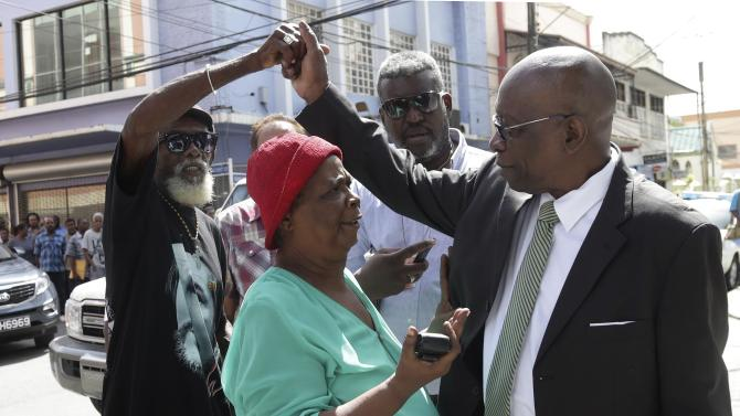 Former FIFA vice-president Jack Warner talks to supporters in Port of Spain