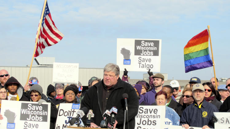 FILE _ In this Nov. 15, 2010 file photo, Wisconsin State AFL-CIO President Phil Neuenfeldt speaks at a Milwaukee rally outside train maker Talgo Inc. on Monday, Nov. 15, 2010, calling on Republican Gov.-elect Scott Walker to drop his opposition to the stateís federally funded high-speed rail project. More than a year after the standoff over union rights that rocked Wisconsin and the nation for weeks, the Republican Governor will face Milwaukee's Democratic Mayor Tom Barrett in Tuesday's recall election.  (AP Photo/Dinesh Ramde, File)