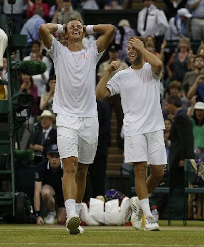 Vasek Pospisil of Canada, left, and Jack Sock of the U.S celebrate defeating Bob Bryan and Mike Bryan of the U.S in the men's doubles final at Wimbled...