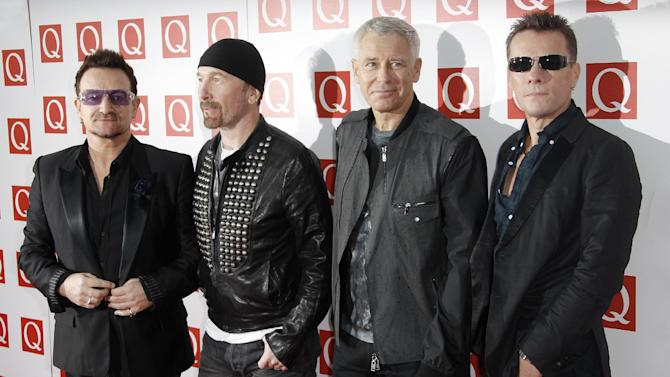 Members of the Irish Band U2 from left, Bono, The Edge, Adam Clayton and Larry Mullen, arrive on the red carpet for the Q Music Magazine Awards at a central London hotel, Monday, Oct. 24, 2011. (AP Photo/Joel Ryan)