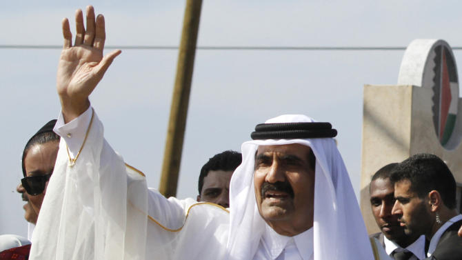 FILE - In this Oct. 23, 2012, file photo, Emir of Qatar Sheikh Hamad bin Khalifa al-Thani waves to the crowd as he and and Gaza's Hamas prime minister Ismail Haniyeh, not pictured, arrive for corner-stone laying ceremony of a Qatari funded rehabilitation center in Gaza City. The emir of Qatar received a hero's welcome in Gaza on Tuesday, becoming the first head of state to visit the Palestinian territory since the Islamist militant Hamas seized control there in 2007. When President Barack Obama meets over the next month with leaders from Mideast and other regional nations, he will have a timely opportunity to try to rally the Syrian opposition's main backers around a unified strategy to oust Syrian President Bashar Assad. Jordan, Turkey, Qatar and the United Arab Emirates _ whose Sunni Muslim leaders will meet separately with Obama starting April 16_ are all believed to be arming or training rebel forces seeking to overthrow Assad's regime. (AP Photo/Hatem Moussa, Pool)