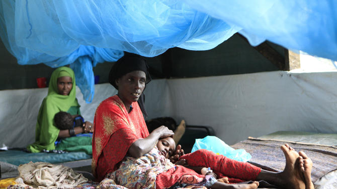 """Somali women soothe their children, who are receiving treatment for malnutrition, at a Doctors Without Borders hospital in Dagahaley Camp, outside Dadaab, Kenya, Monday, July 11, 2011. U.N. refugee chief Antonio Guterres said Sunday that drought-ridden Somalia is the """"worst humanitarian disaster"""" in the world, after meeting with refugees who endured unspeakable hardship to reach the world's largest refugee camp in Dadaab, Kenya. (AP Photo/Rebecca Blackwell)"""