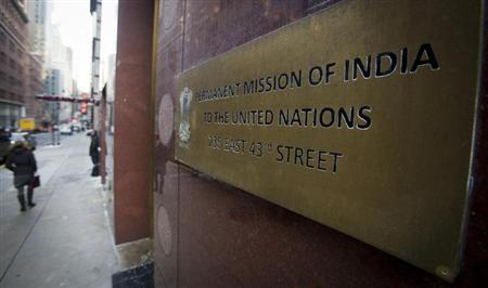 People walk past the Indian Mission to the United Nations building in New York