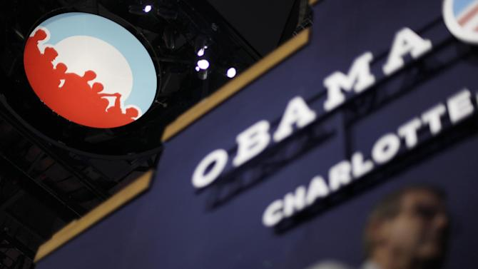 Obama campaign logo is seen under the scoreboard hanging from the ceiling inside of Time Warner Cable Arena at the Democratic National Convention in Charlotte, N.C., on Monday, Sept. 3, 2012. (AP Photo/David Goldman)