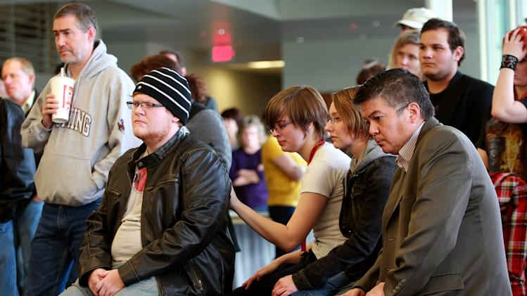 Students and staff listen to a news conference after an apparent murder-suicide on campus Friday, Nov. 30, 2012 at Casper College in Casper, Wyo. Police say a male suspect killed two people with an edged weapon before killing himself in a classroom at the college where students were present.  Police found two of those killed at a science building on the Casper College campus and the third at another location about 2 miles away. Authorities didn't identify the suspect or victims but said two were male and one was female. The suspect wasn't believed to be a student, but it appeared there was a relationship between the suspect and victims killed, Police Chief Chris Walsh said.  (AP Photo/The Casper Star-Tribune, Alan Rogers)  MANDATORY CREDIT  TRIB.COM