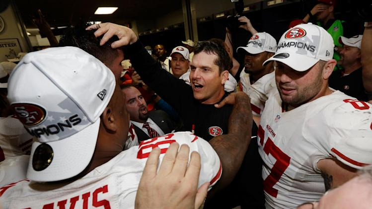 San Francisco 49ers head coach Jim Harbaugh celebrates with his team after the NFL football NFC Championship game against the Atlanta Falcons Sunday, Jan. 20, 2013, in Atlanta. The 49ers won 28-24 to advance to Super Bowl XLVII. (AP Photo/Dave Martin)
