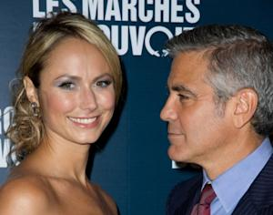 Stacy Keibler and George Clooney exchange a smile at 'The Ides of March' Paris Premiere at Cinema UGC Normandie in Paris, France, on October 18, 2011  -- Getty Premium