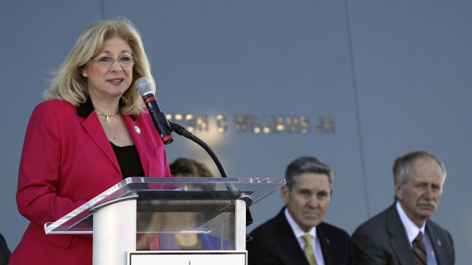 Evelyn Husband-Thompson, left, widow of Colonel Rick Husband, space shuttle Columbia commander, speaks at a remembrance ceremony on the 10th anniversary of the loss of space shuttle Columbia crew at the Kennedy Space Center Visitor Complex, Friday, Feb. 1, 2013, in Cape Canaveral, Fla. To her right is NASA Kennedy Space Center director, Bob Cabana and NASA Human Exploration and Operations associate administrator, William Gerstenmaier. (AP Photo/John Raoux)