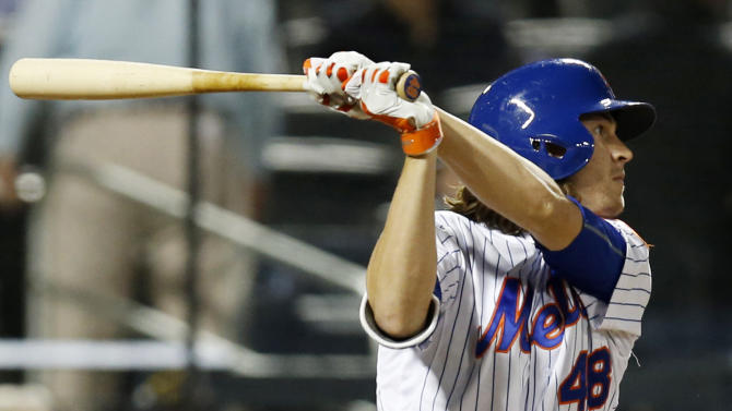 New York Mets' Jacob deGrom hits a fourth-inning single to center field in a baseball game against the Baltimore Orioles in New York, Wednesday, May 6, 2015. (AP Photo/Kathy Willens)