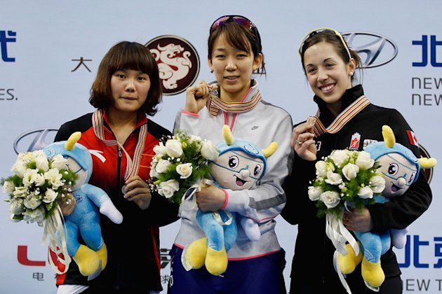 (L-R) Li Jianrou Of China, Cho Ha-ri Of Korea And Valerie Maltais Of Canada Pose Getty Images