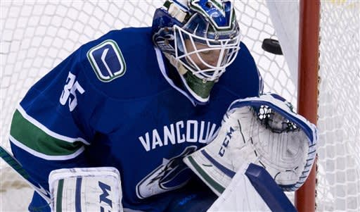 Stars rally to end Canucks' winning streak, 4-3