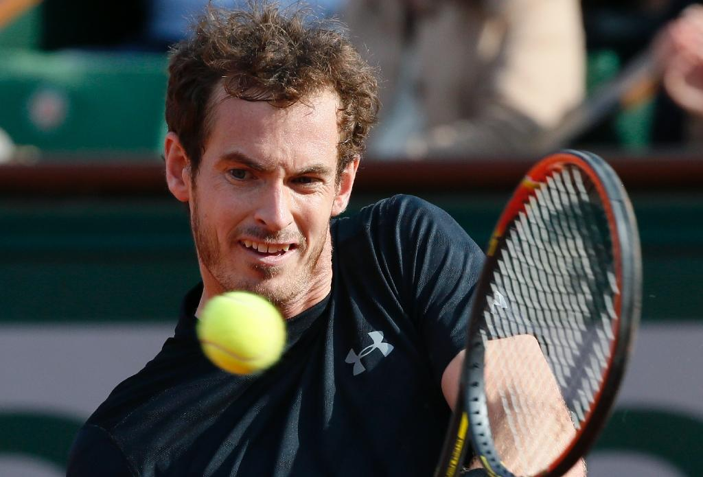 Murray overcomes tricky conditions in opening win