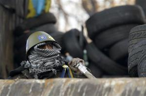 Anti-government protester is seen at the barricades in Kiev