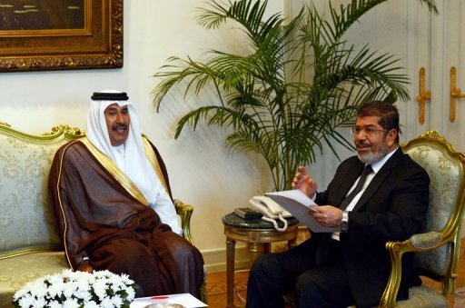 Egyptian President Mohamed Morsi (R) meets with Qatari Prime Minister Sheikh Hamad bin Jassem at the presidential palace in Cairo. The Qatari PM said on Thursday his country will invest $18 billion in Egypt over the next five years to help shore up the economy, which has taken a beating since last year's uprising