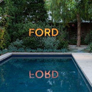 Before: Auto dealership sign, After: Poolside decor