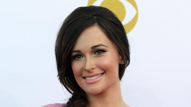 Kacey Musgraves arrives at the 50th annual Academy of Country Music Awards at AT&T Stadium on Sunday, April 19, 2015, in Arlington, Texas. (Photo by Jack Plunkett/Invision/AP)