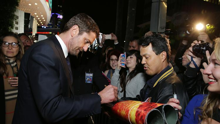 Gerard Butler at FilmDistrict's Premiere of 'Olympus Has Fallen' hosted by Brioni and Grey Goose at the ArcLight Hollywood, on Monday, March, 18, 2013 in Los Angeles. (Photo by Eric Charbonneau/Invision for FilmDistrict/AP Images)