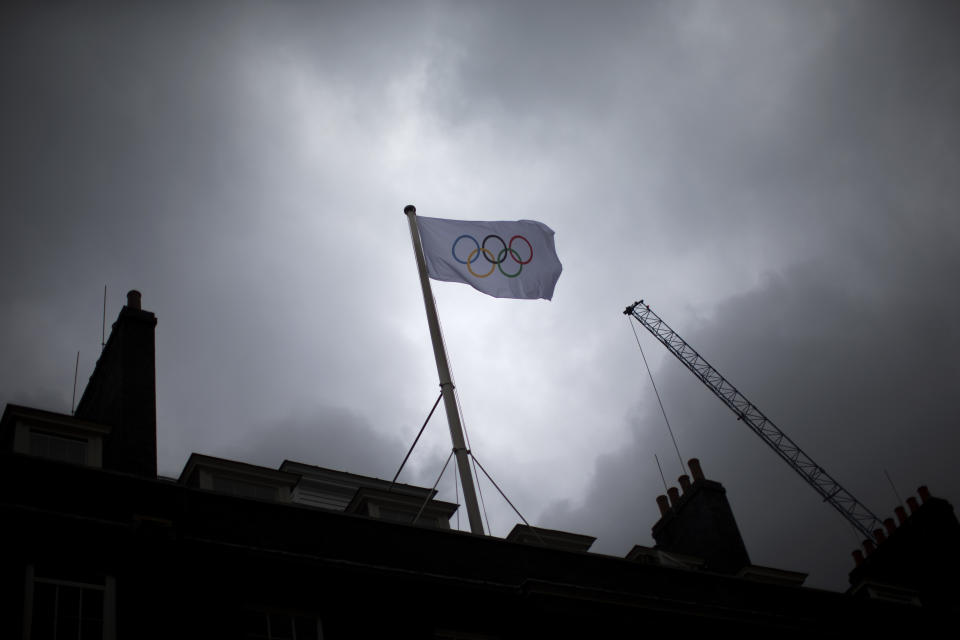 An Olympic flag flies over Downing Street in London, after being raised for the first time there this morning, Friday, July 20, 2012.  (AP Photo/Matt Dunham)