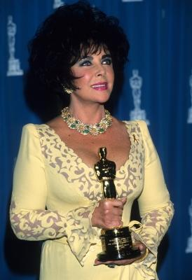 Elizabeth Taylor poses with her Oscar at the 65th Annual Academy Awards at the Shrine Auditorium in Los Angeles on March 29, 1993  -- WireImage