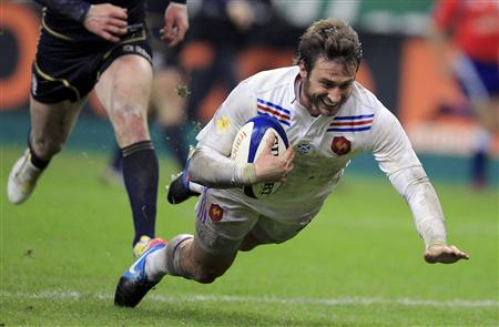 France's Maxime Medard scores a try during their Six Nations rugby union match against Scotland at the Stade de France in Saint-Denis