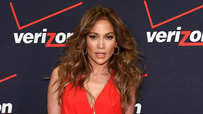 FILE - This Jan. 26, 2013 file photo released by Verizon Wireless shows singer Jennifer Lopez at the Verizon Wireless meet Jennifer Lopez Flyaway Contest in Santa Monica, Calif. Lopez is the newly appointed chief creative officer of the NUVOtv network.  The versatile superstar was announced last fall as a creative partner with the English-language Latino network. But her role was solidified Wednesday as NUVOtv prepared to relaunch with a new programming slate July 18.  Lopez says that with the support of her own production company, she will be involved in marketing, branding and program development at the network.  (AP Photo/Verizon Wireless, Casey Rodgers, file)