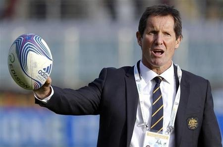 Australia's coach Deans gestures holding a ball during their test rugby union match against Italy in Florence